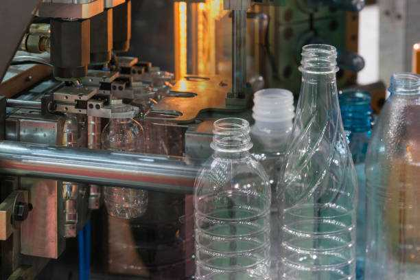 The abstract scene of plastic bottling process.The Blowing of plastic bottle manufacturing process.